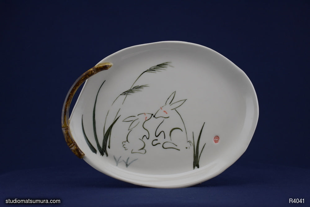 Handmade dinnerware with Sumi-e drawings of a Rabbit