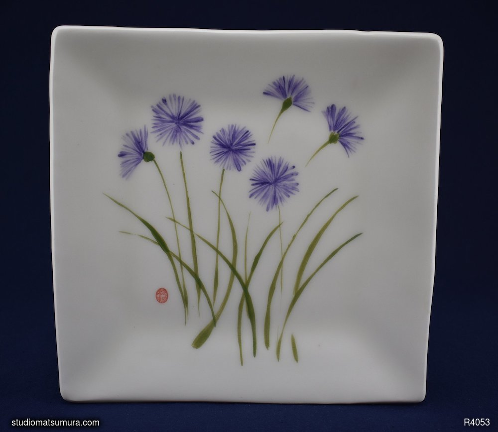Handmade dinnerware with Sumi-e drawings of a Cupid Flower, variant 2
