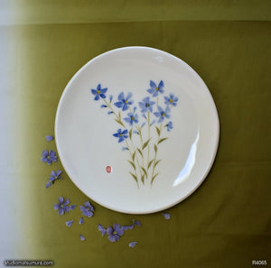 Another angle of  Handmade dinnerware with Sumi-e drawings of a Blue Flax