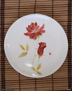 Another angle of  Handmade dinnerware with Sumi-e drawings of a Rose, round plate