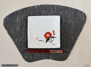 Another angle of  Handmade dinnerware with Sumi-e drawings of a Camellia (right)