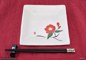 Handmade dinnerware with Sumi-e drawings of a Camellia (right), another image