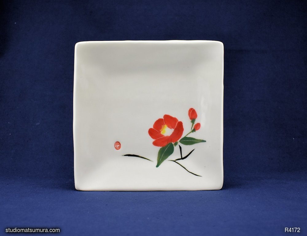 Handmade dinnerware with Sumi-e drawings of a Camellia (right)