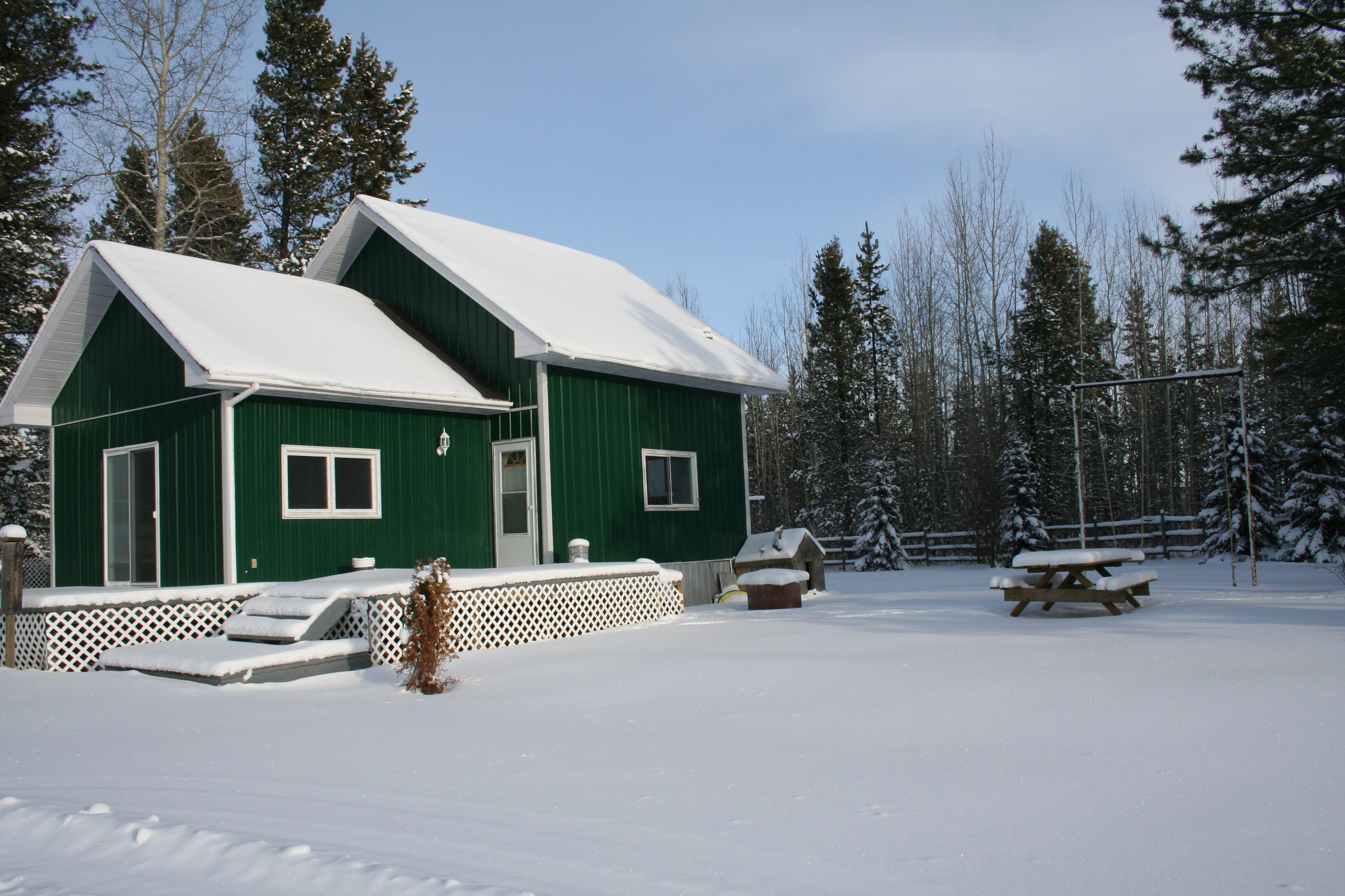 Last West Outfitting hunting lodge during winter time under the snow