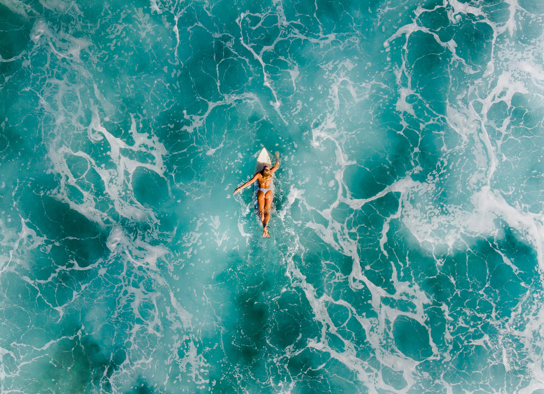 Frothy Surfer Girl Drone Shot