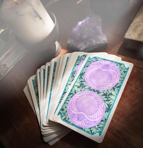 spiritual books and tarot cards