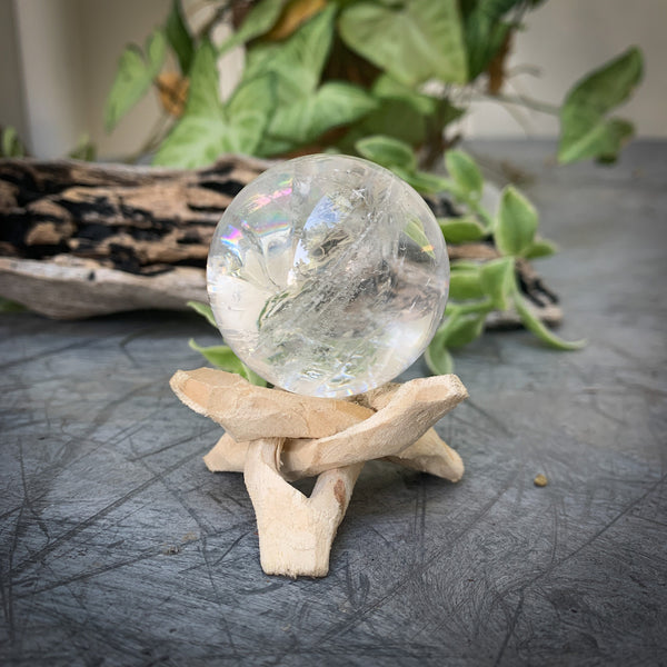 QUARTZ CRYSTAL ORB WITH RAINBOWS