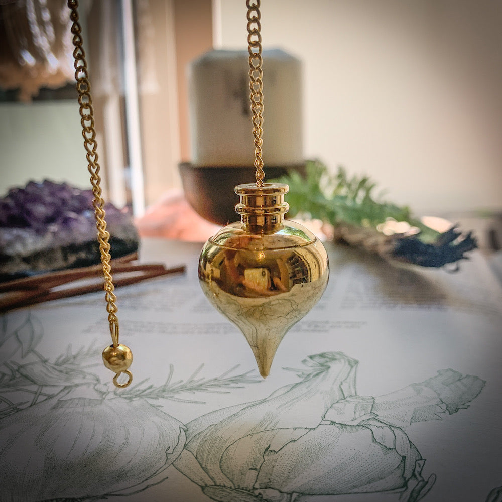 Golden vial pendulum hanging