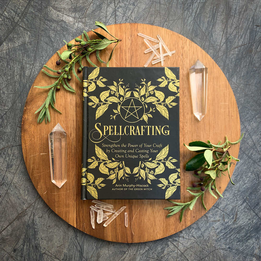 Spellcrafting Book with quartz crystals