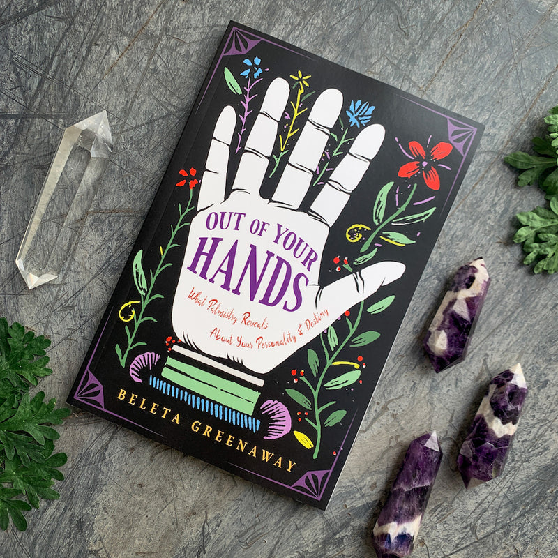 Out of Your Hands book by Beleta Greenaway with chevron amethyst and clear quartz