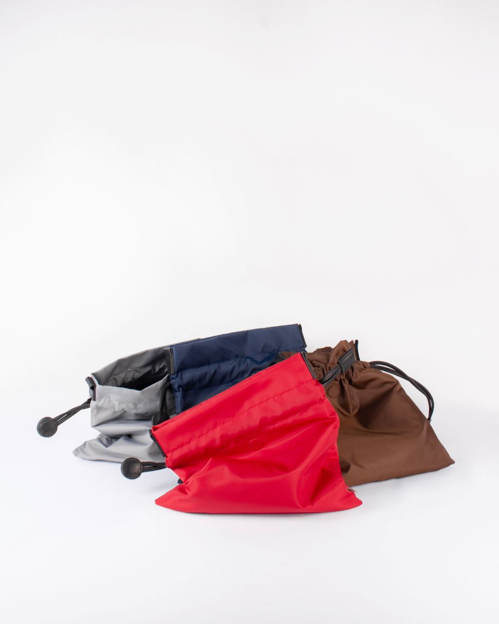 beans bag in red water repellent nylon and leather strap grey navy red brown