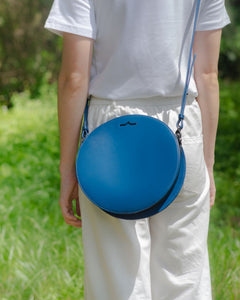 Blue circle Napa leather shoulder crossbody on model front