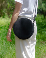 black circle cow leather crossbody on model