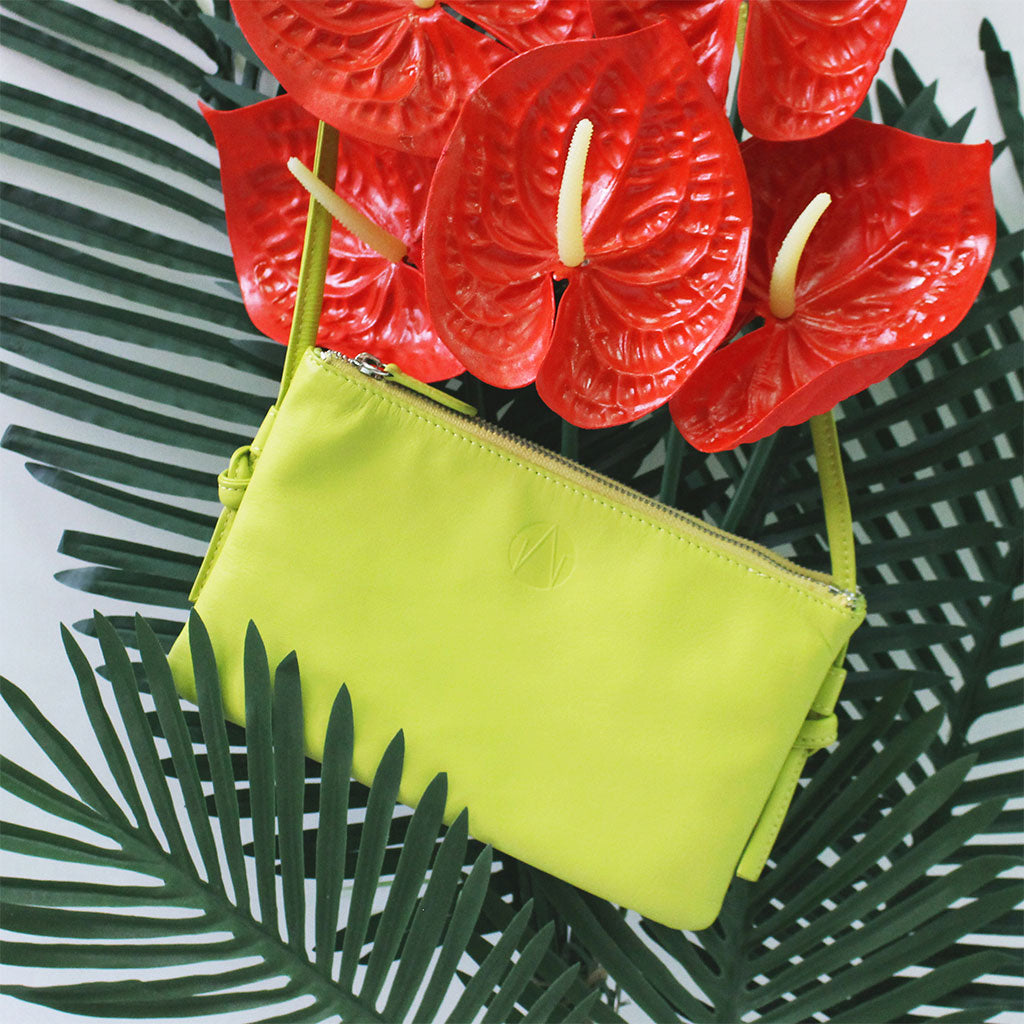 TAT_normcore_crossbody_14632_lemongreen_front styling photo shoot with flowers and leaves