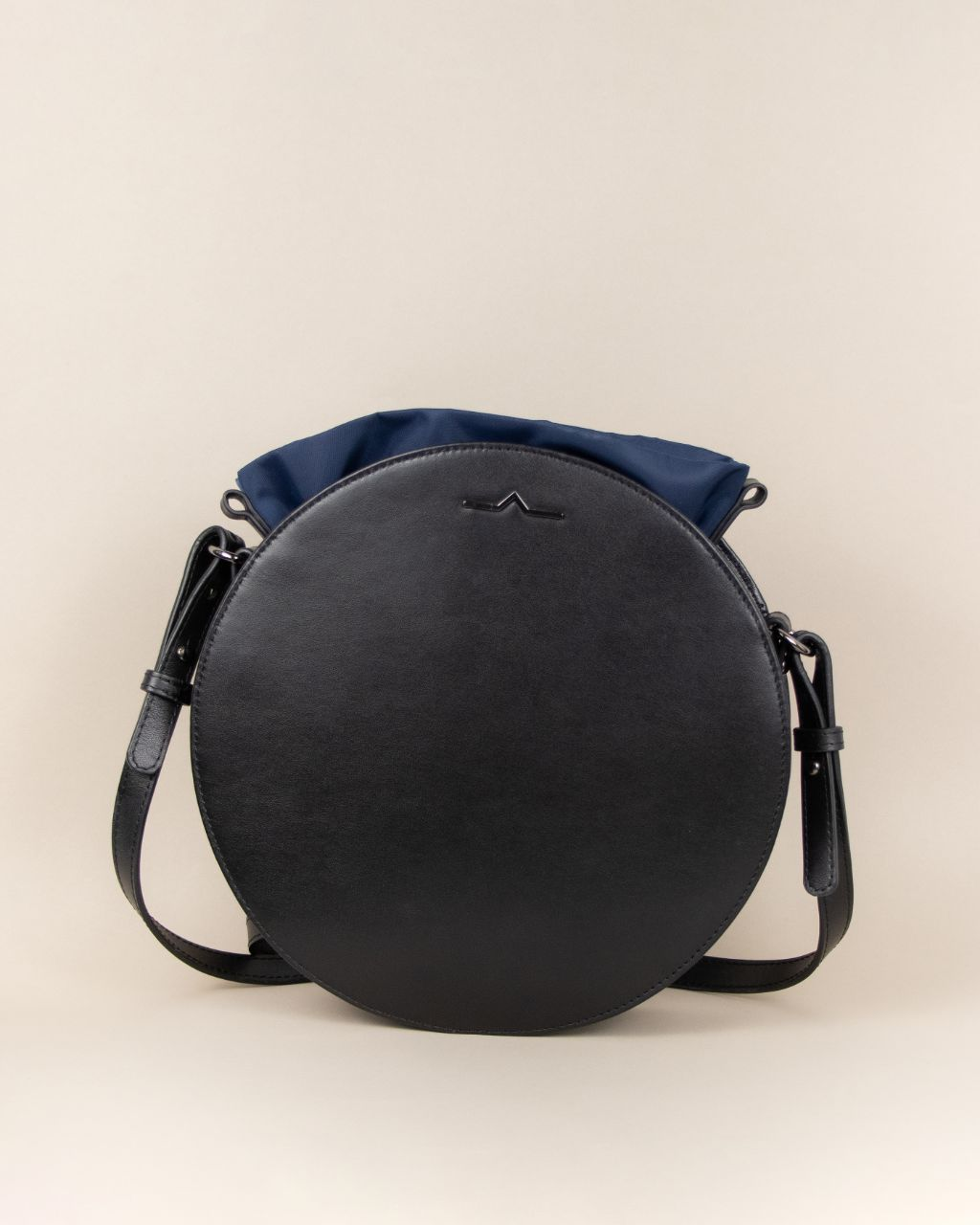 black circle cow leather crossbody with navy nylon beans bag set