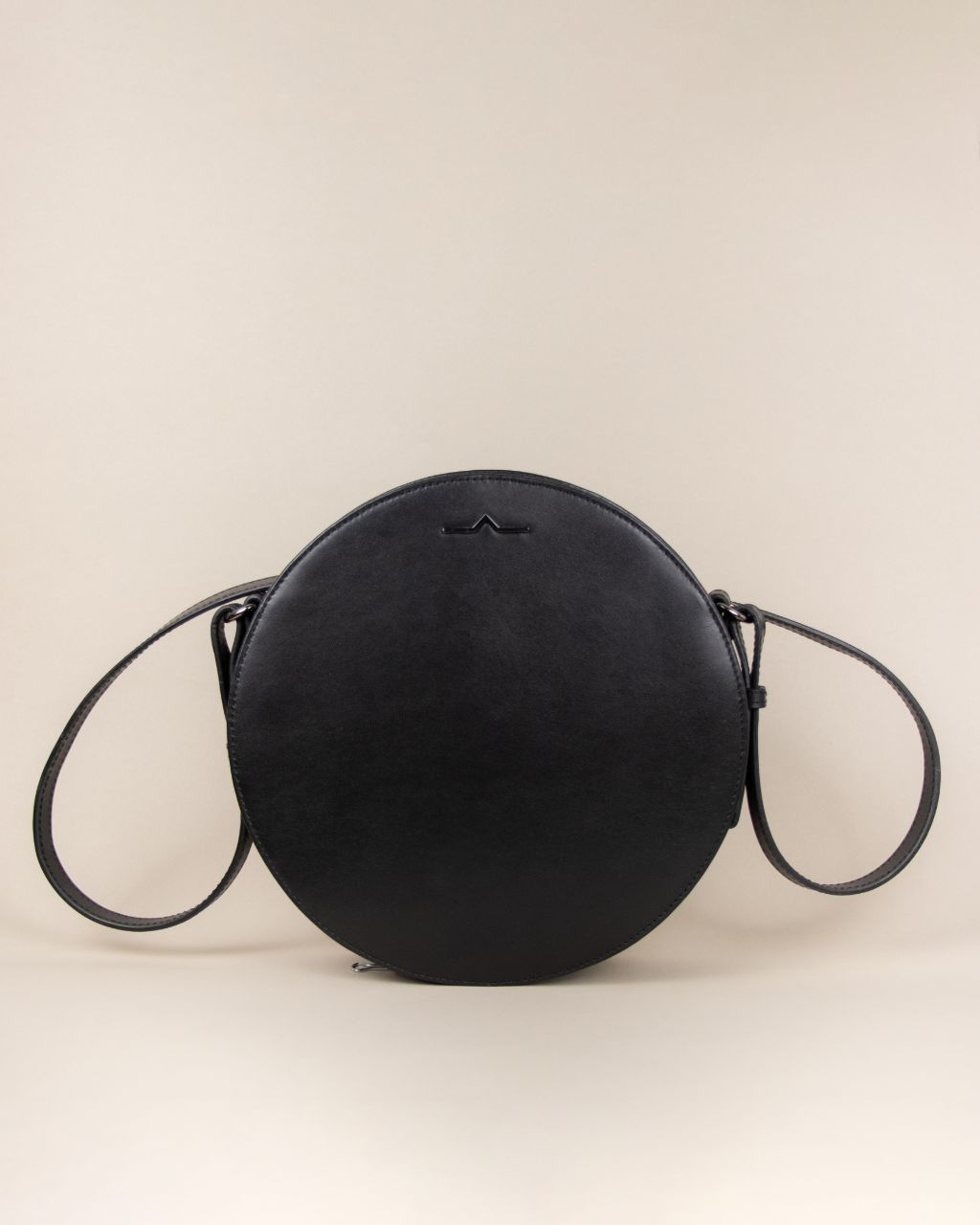 black circle cow leather crossbody with shoulder strap