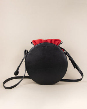 black circle cow leather crossbody with red nylon beans bag set