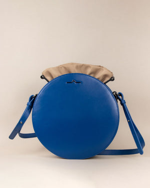 blue round cow leather crossbody with beige nylon beans bag set