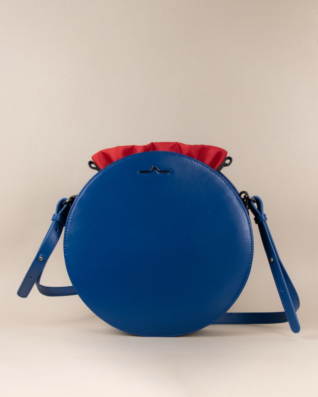 blue round cow leather crossbody with red nylon beans bag set