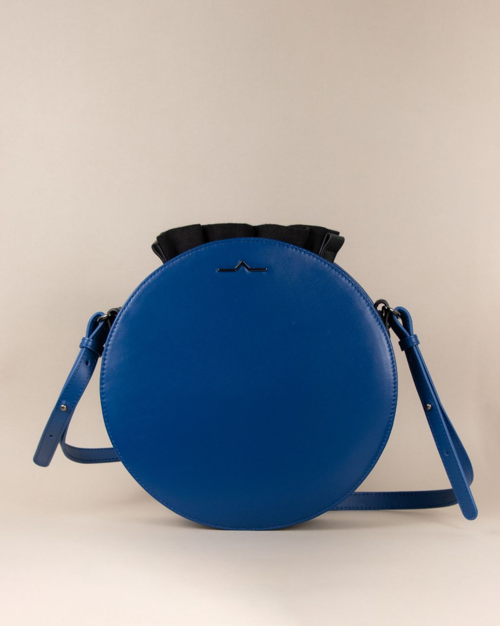 blue round cow leather crossbody with black nylon beans bag set