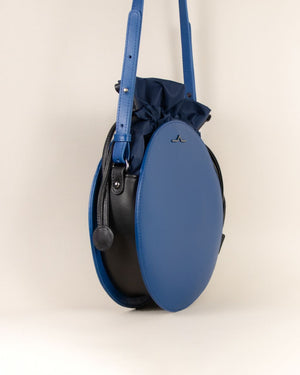 Blue round cow leather crossbody with nylon beans bag set side