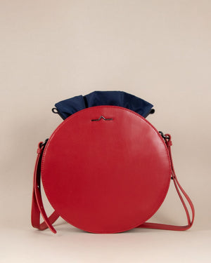 Red round cow leather crossbody with navy nylon beans bag set