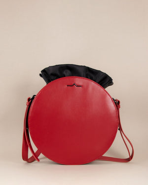 Red round cow leather crossbody with blacknylon beans bag set
