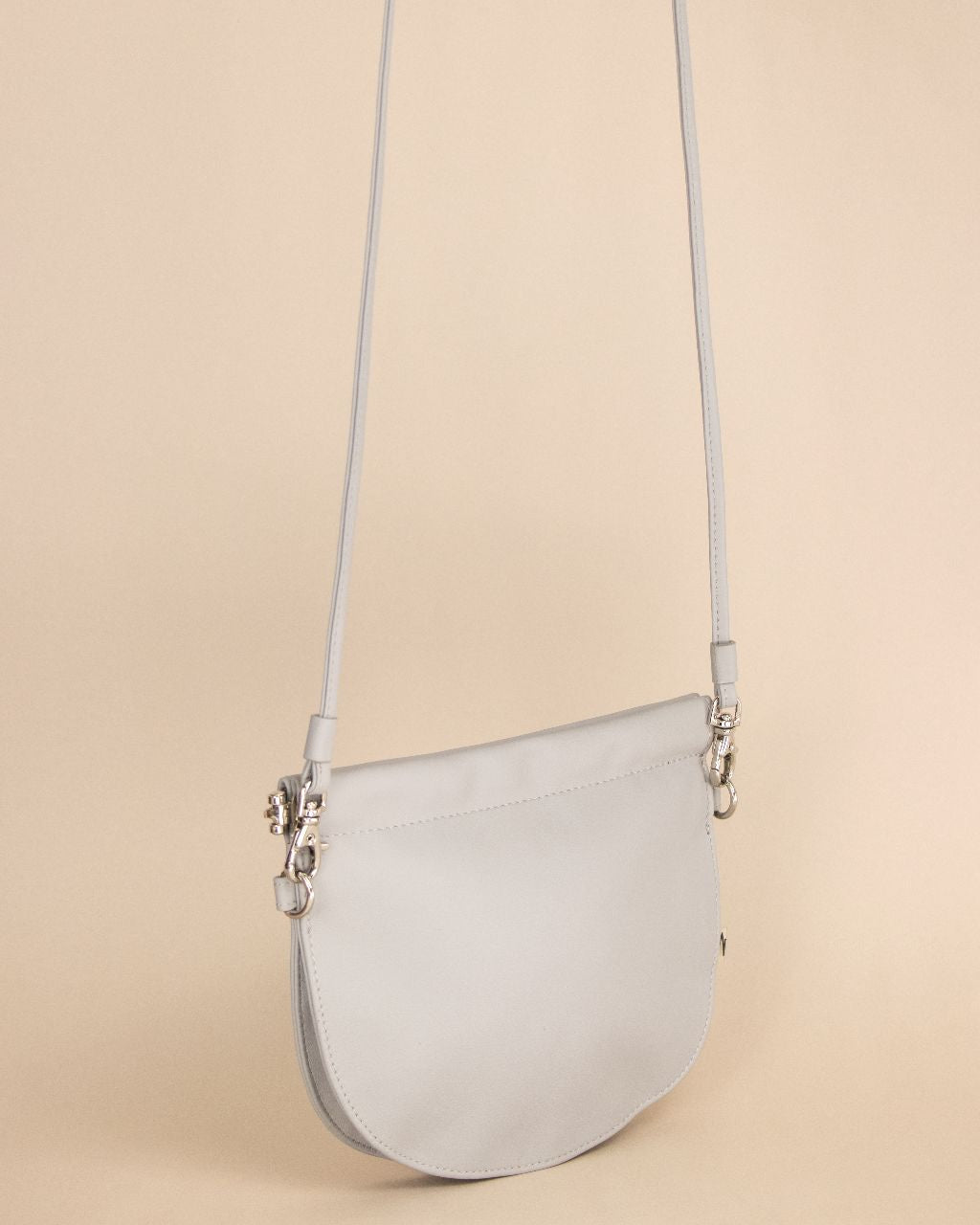 TAT_halfmoon_mini_crossbody-front with shoulder strap