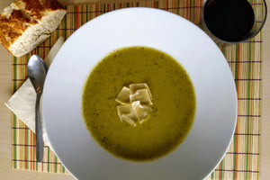 Creamy courgette and green pea soup with parmesan flakes (v)