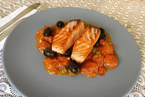 Salmon with black olives and cherry tomatoes