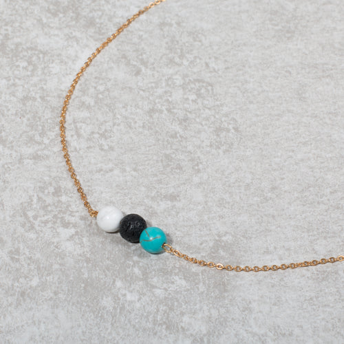 PEACE Essential Oil Diffuser Necklace Howlite & Turquoise - Diffuser Necklaces - Altruis Living
