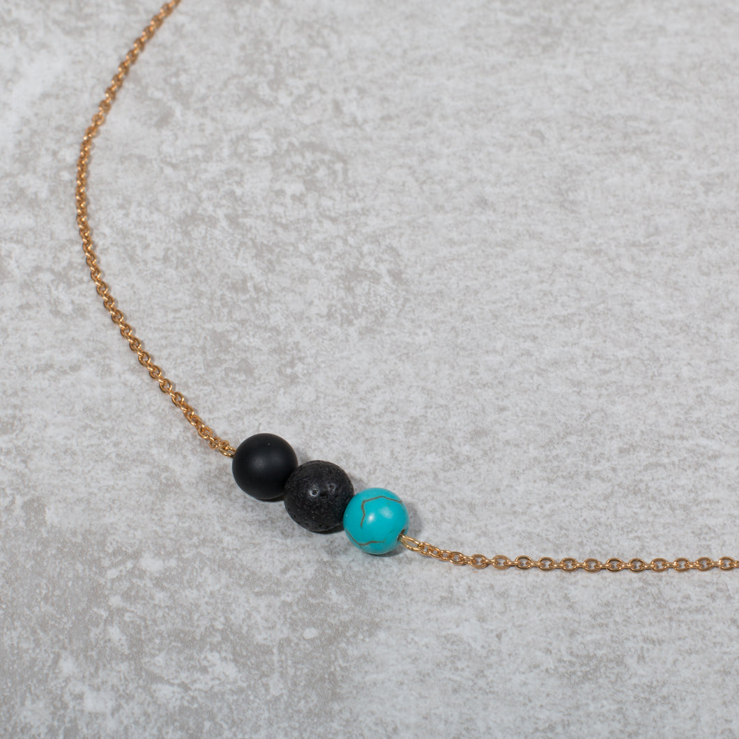 TRANQUILITY Essential Oil Diffuser Necklace Black Onyx & Turquoise - Diffuser Necklaces - Altruis Living