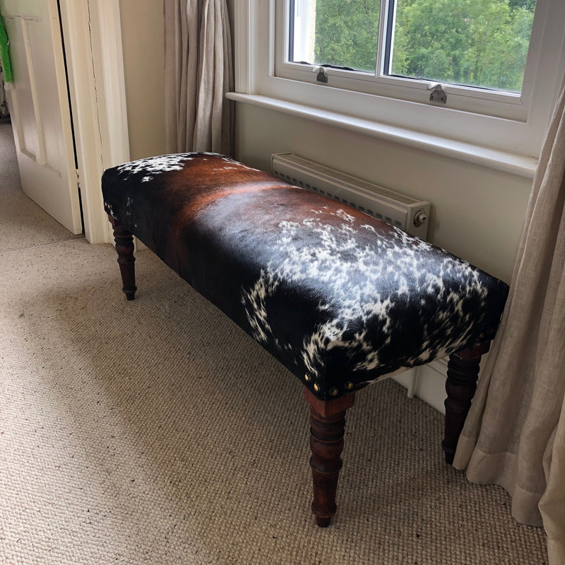 Cowhide Footstool/Ottoman - Tri-Colour on Tall Turned Wooden Legs