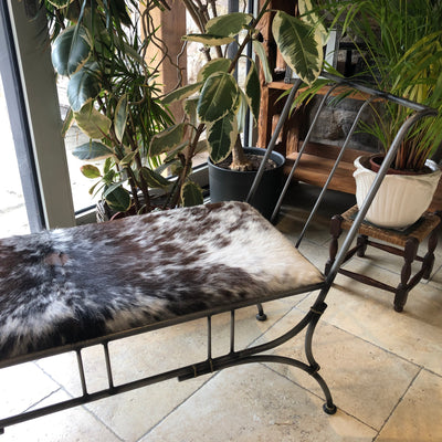 Wrought Iron Bench Upholstered in Long Haired Cowhide