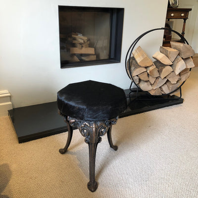 Antique Brass Stool Upholstered in Black Cowhide on Intricate Elephant Legs