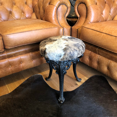 Antique Iron Stool Upholstered in Tricolour Brindle Cowhide on Intricate Elephant Legs
