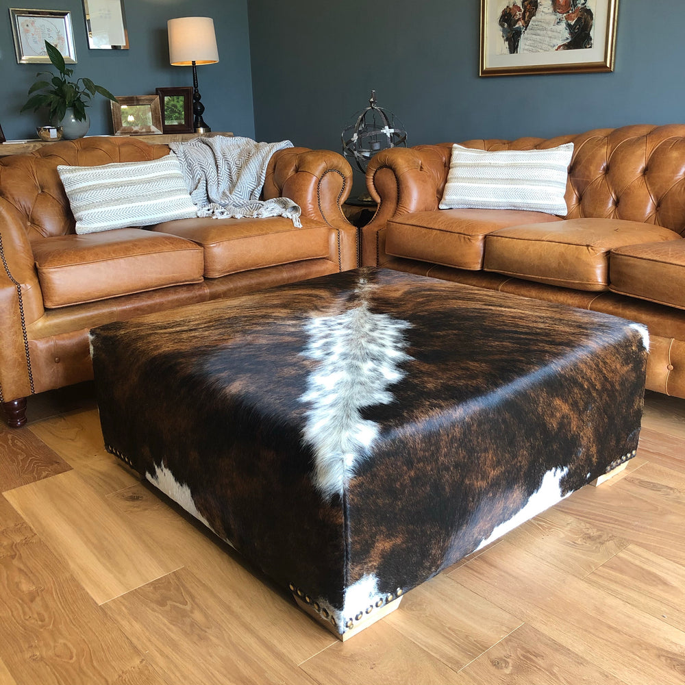 Large cowhide footstool coffee table