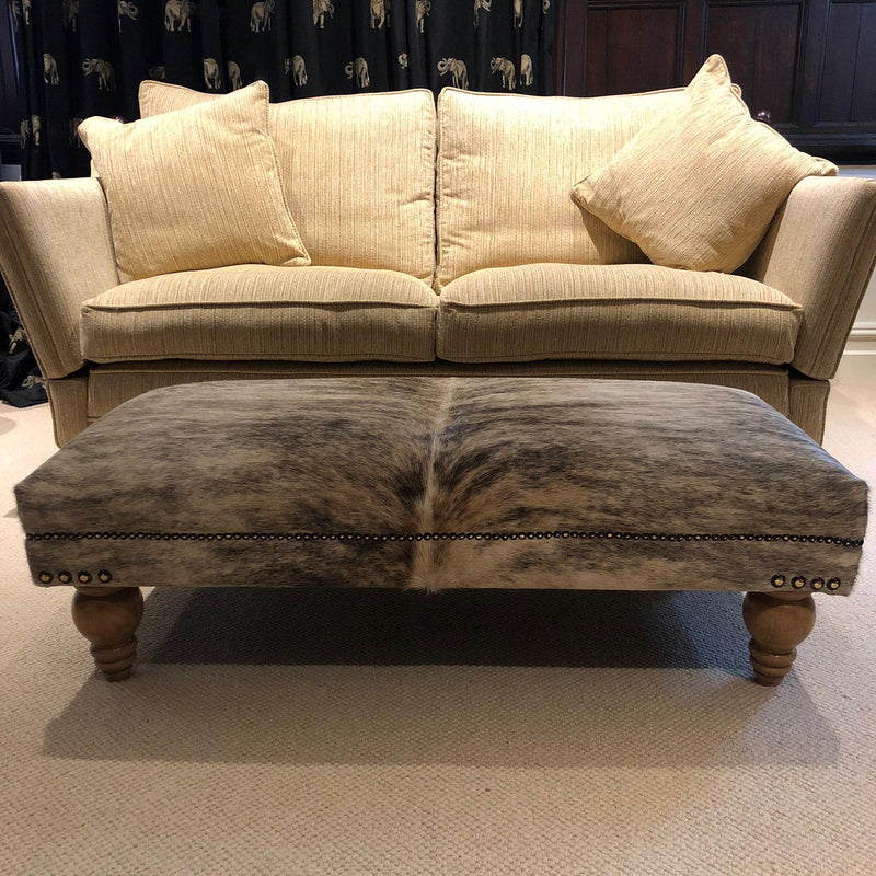 Cowhide Footstool/Ottoman - Beige Brindle on Turned Wooden Legs