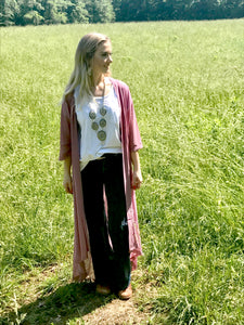 Model in field wearing pink duster