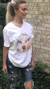 white V neck Tshirt with a cow and floral band around the cow