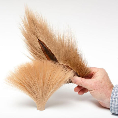 Faux Bucktail next to Natural Bucktail Flymen Fly Tying