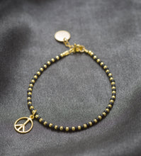 Load image into Gallery viewer, Peace bracelet in black and gold