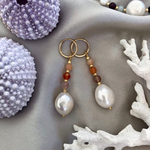 Baroque freshwater pearls and sparkling gemstones