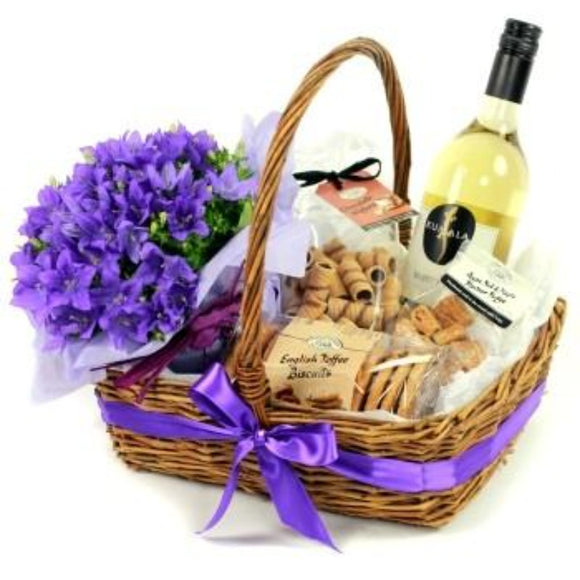Wine & Snacks & Seasonal Plant Unwrapped Basket ¦ Gift Basket Unwrapped A Wine Lovers