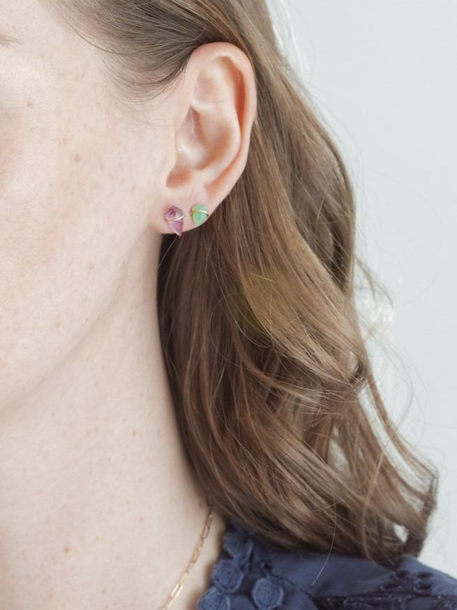 Model wearing small and teeny kite studs in 18kt gold.
