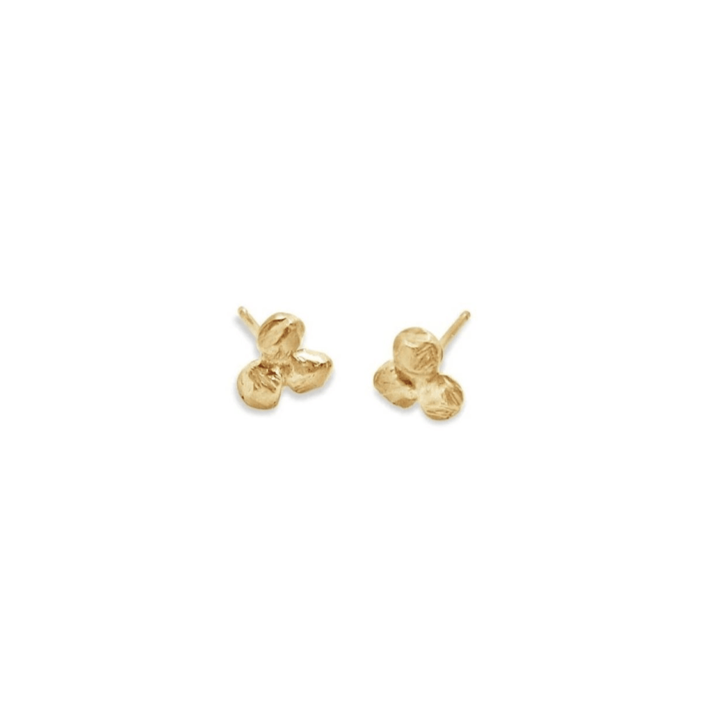 Handmade 18kt gold stud earrings with three carved dots.