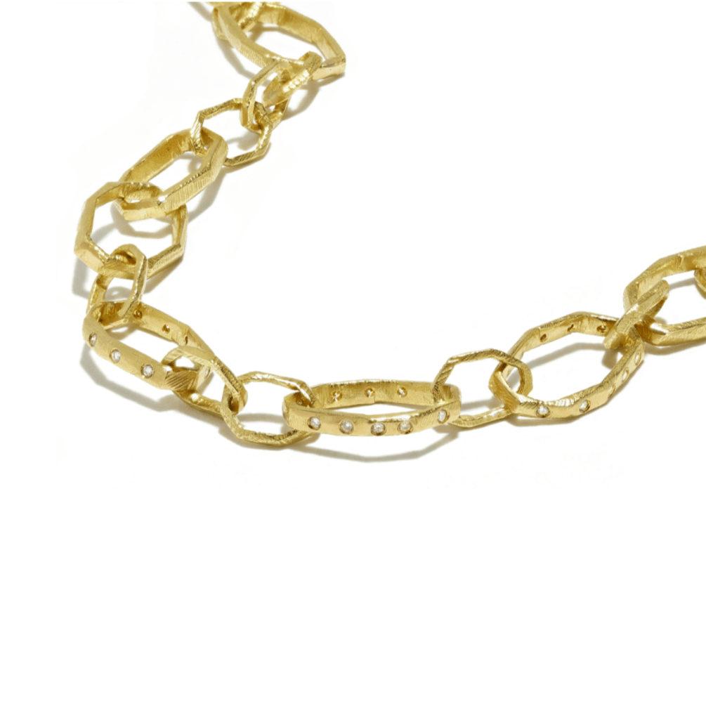Handmade 18kt gold chain made from handcarved links with diamonds.