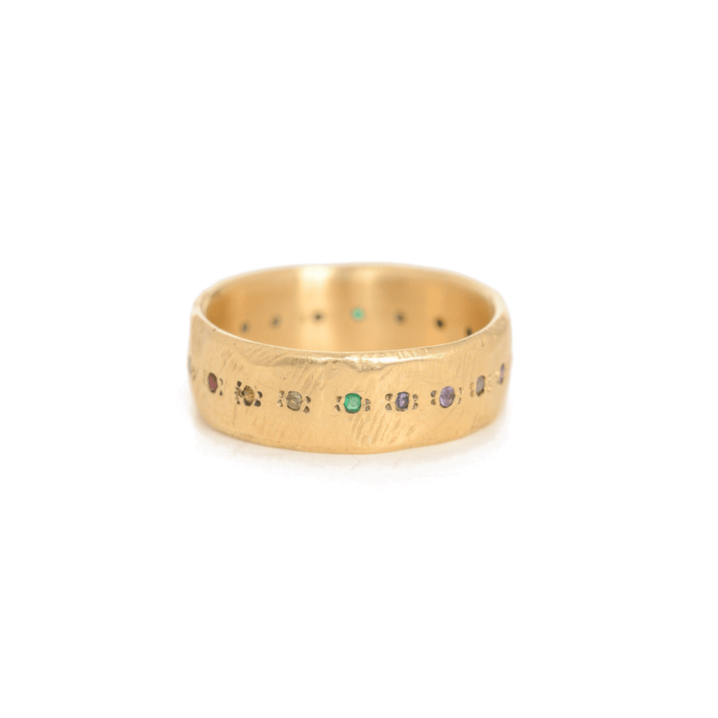 Handmade 18kt gold ring with rainbow sapphires.
