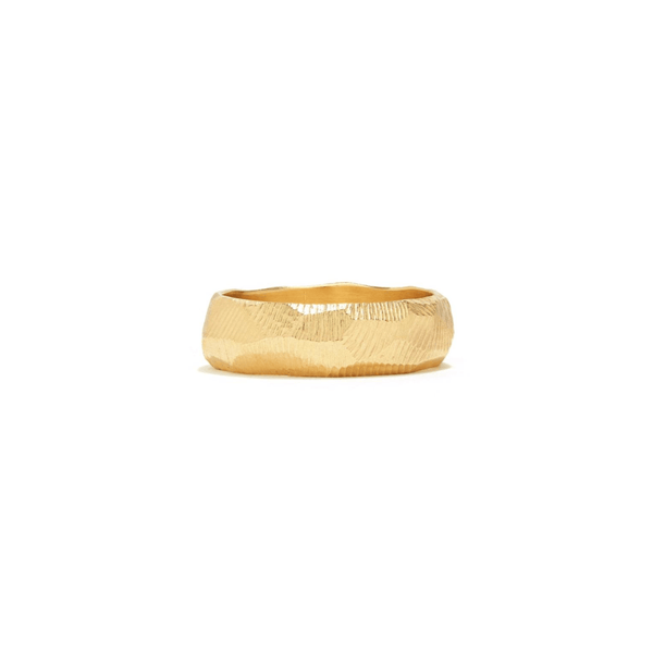 Handmade wedding band in 18kt gold with a 6mm width and hand carved texture.