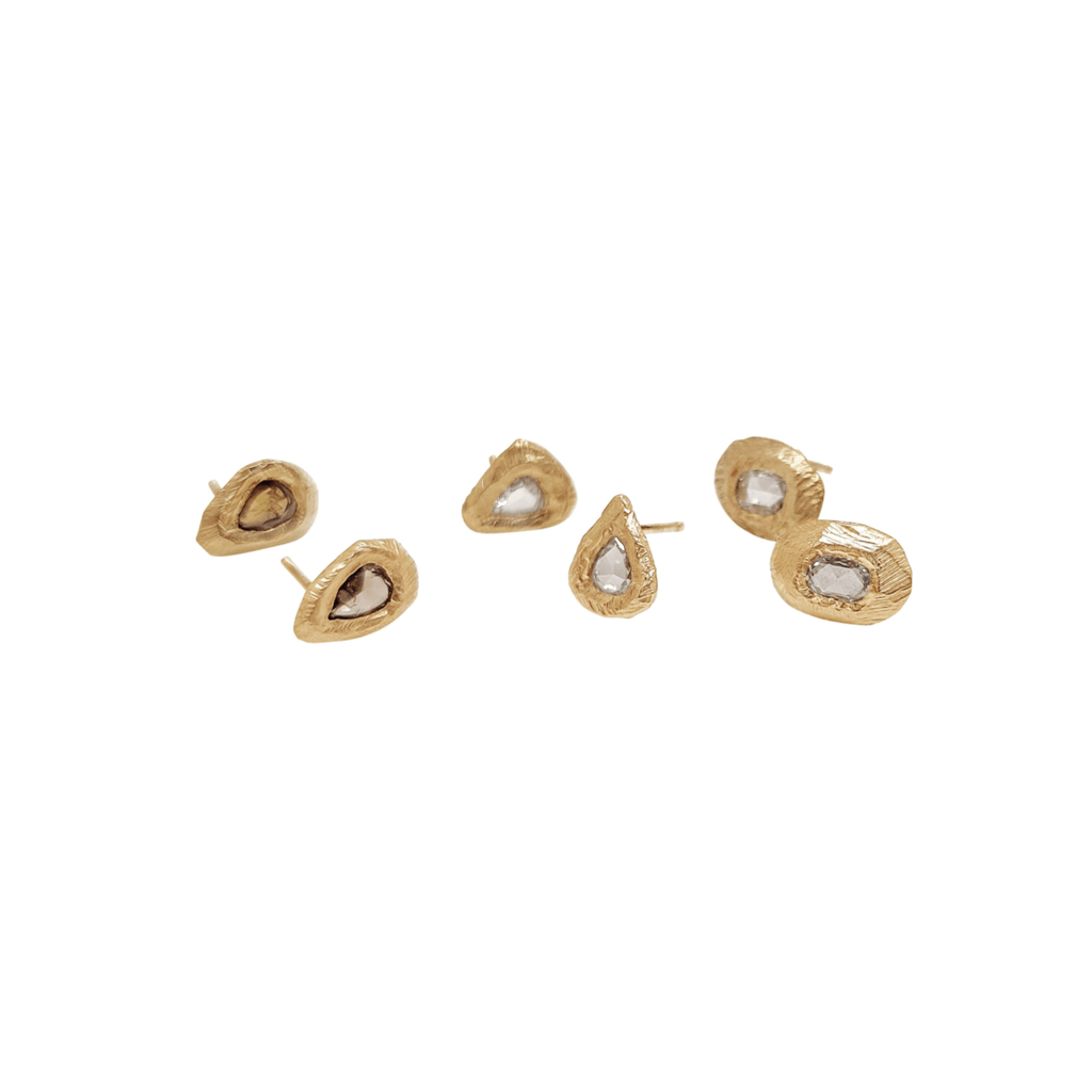 Handmade stud earrings in 18kt gold with pear shaped cognac diamonds and rosecut white diamonds.